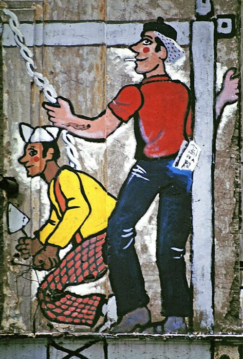 Via di Tor di Nona, 1977. Collettivo L'Asino che vola: grandi murali su lotta per la casa e appropriazione del quartiere da parte dei ceti popolari.
